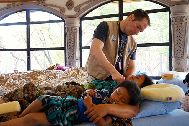 James Mezzapelli treating a patient in Guatemala